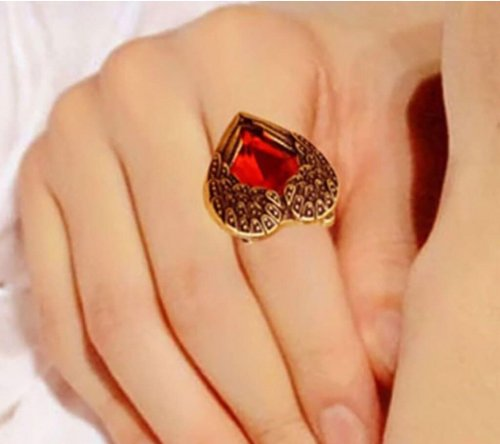 golden color red stone ring